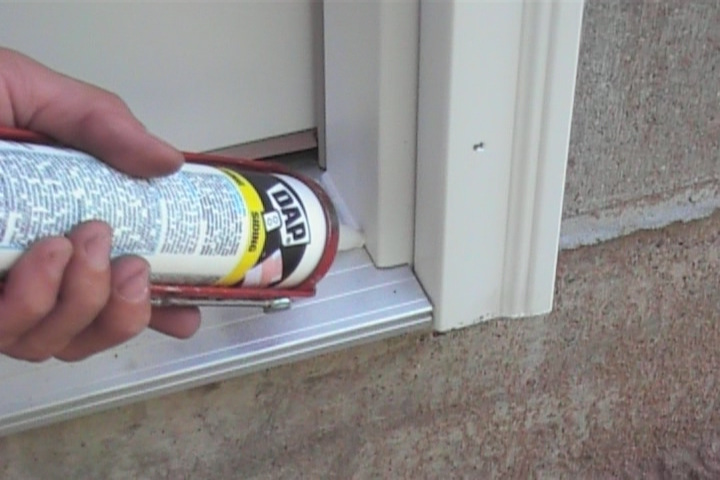Caulking a door sill after rotten wood replacement